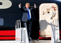 Republican presidential candidate Donald Trump gives as thumbs-up as he arrives for a campaign rally, Wednesday, Dec. 16, 2015, in Mesa, Ariz. (AP Photo/Matt York)