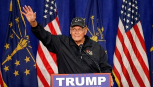 Former Purdue basketball coach Gene Keady talks about Republican presidential candidate Donald Trump during a campaign stop Monday, May 2, 2016, in South Bend, Ind. (AP Photo/Charles Rex Arbogast)