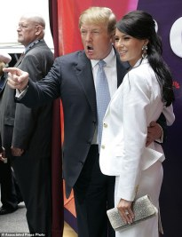 """FILE - In this Monday, May 17, 2004 file photo, Donald Trump, center, star of the television show """"The Apprentice,"""" and his fiancee, Melania Knauss, right, arrive for NBC's presentation of its fall season to advertisers at Radio City Music Hall in New York. Randal Pinkett, who won the program in December 2005 and who has recently criticized Trump during his 2016 run for president, said he remembered the real estate mogul talking about which contestants he wanted to sleep with, even though Trump had married Melania, a former model, earlier that year: """"He was like 'Isn't she hot, check her out,' kind of gawking, something to the effect of 'I'd like to hit that.'"""" (AP Photo/John Marshall Mantel)"""