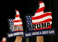 A group of supporters wave signs prior to a speech by Republican presidential hopeful Donald Trump during a rally in Richmond, Va., Wednesday, Oct. 14, 2015. (AP Photo/Steve Helber)