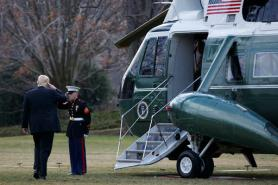 President Donald Trump salutes before boarding Marine One on the South Lawn of the White House in Washington, Thursday, Jan. 26, 2017, for a short trip to Andrews Air Force Base, Md., then onto Philadelphia for the Republican Congressional retreat. (AP Photo/Evan Vucci)