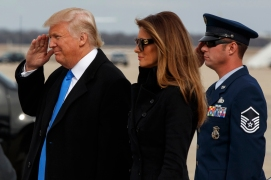 President-elect Donald Trump salutes as he and his wife Melania arrive at Andrews Air Force Base, Md., Thursday, Jan. 19, 2017, ahead of Friday's inauguration. (AP Photo/Evan Vucci)