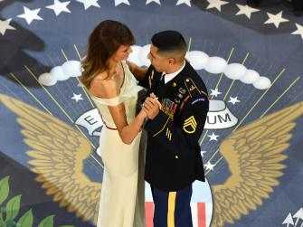 First lady Melania Trump dances with Army Staff Sgt. Jose A. Medina, who is from Ponce, Puerto Rico and served in Iraq and Afghanistan.