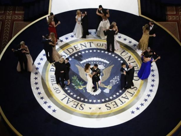 "U.S. President Donald Trump and his wife and family dance with U.S. military service members at the ""Salute to Our Armed Forces"" inaugural ball during inauguration festivities in Washington"
