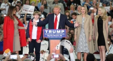 Republican presidential candidate Donald Trump, middle, speaks near his wife, Melania, left, son Baron, daughter Ivanka, second from right, and daughter Tiffany during a campaign event at the Myrtle Beach Convention Center on Tuesday, Nov. 24, 2015, in Myrtle Beach, S.C. (AP Photo/Willis Glassgow)