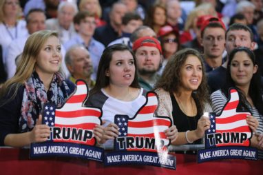 RICHMOND, VA - OCTOBER 14: Supporters wait for presidential candidate and Republican front-runner Donald Trump at a campaign rally at the Richmond International Raceway October 14, 2015 in Richmond, Virginia. A New York real estate mogul and reality television star, Trump is now in a statistical tie with retired neurosurgeon Ben Carson in a Fox News survey of likely Republican voters released Tuesday. (Photo by Chip Somodevilla/Getty Images)