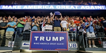 Supporters for Republican presidential candidate Donald Trump applaud the singing of the National Anthem during a rally in Richmond, Va., Friday, June 10, 2016. (AP Photo/Steve Helber)